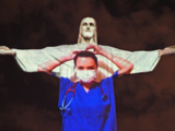 In Rio, Christ the Redeemer statue lit up as doctor to tribute all the health workers!